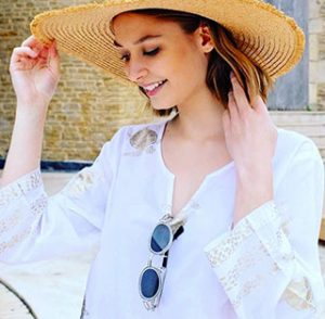 Girl in hat and sunglasses